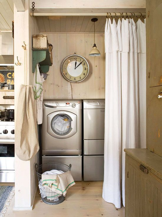 Closet doors replaced with simple canvas curtains and turned into laundry  space.