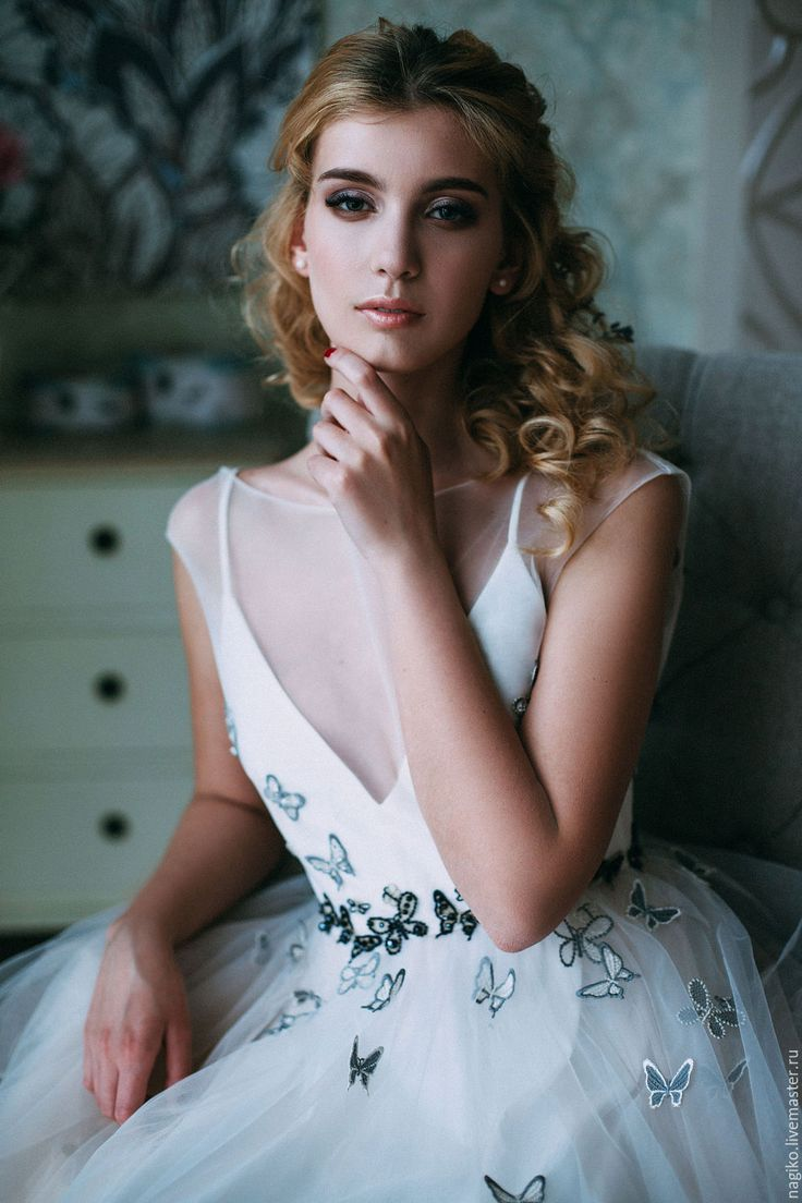 Wedding dress with butterfly embellishment