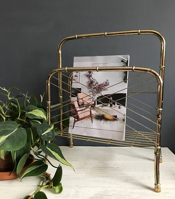 Vintage Gold Brass Bamboo Magazine Rack / Mid Century Modern magazine rack / Bamboo Style Rack for Books, Magazines, Records Vintage brass bamboo magazine rack Hold magazines, records, or books Has rubber feet Good vintage condition Does show signs of age (see photos) Measurements: