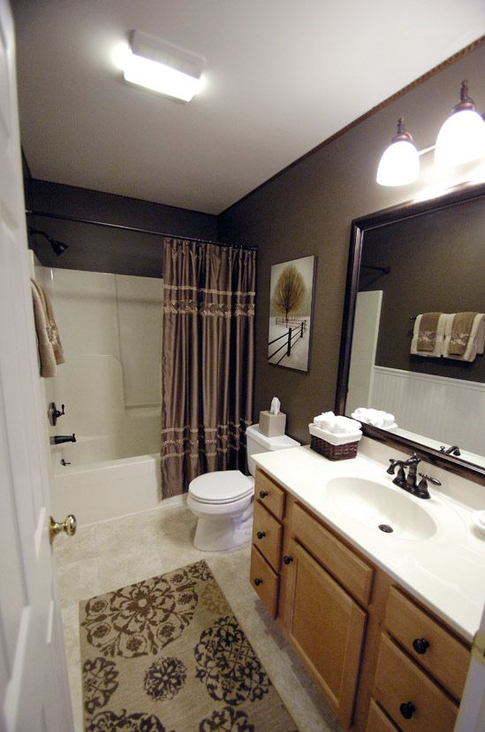 love this cozy bathroom set up - Bathroom Decorating Ideas Brown Walls