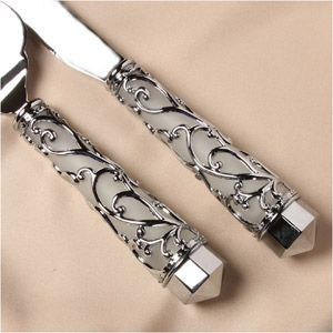 Entwined Wedding Cake Serving Set - WeddingDepot.com - 122-10-9006 An elegant interpretation of royalty and garden influence, the Entwined Cake Serving set uses highly polished silver plated scrolls that resembles an English garden.  The scrolls surround a frosted glass center for a solid quality feel.