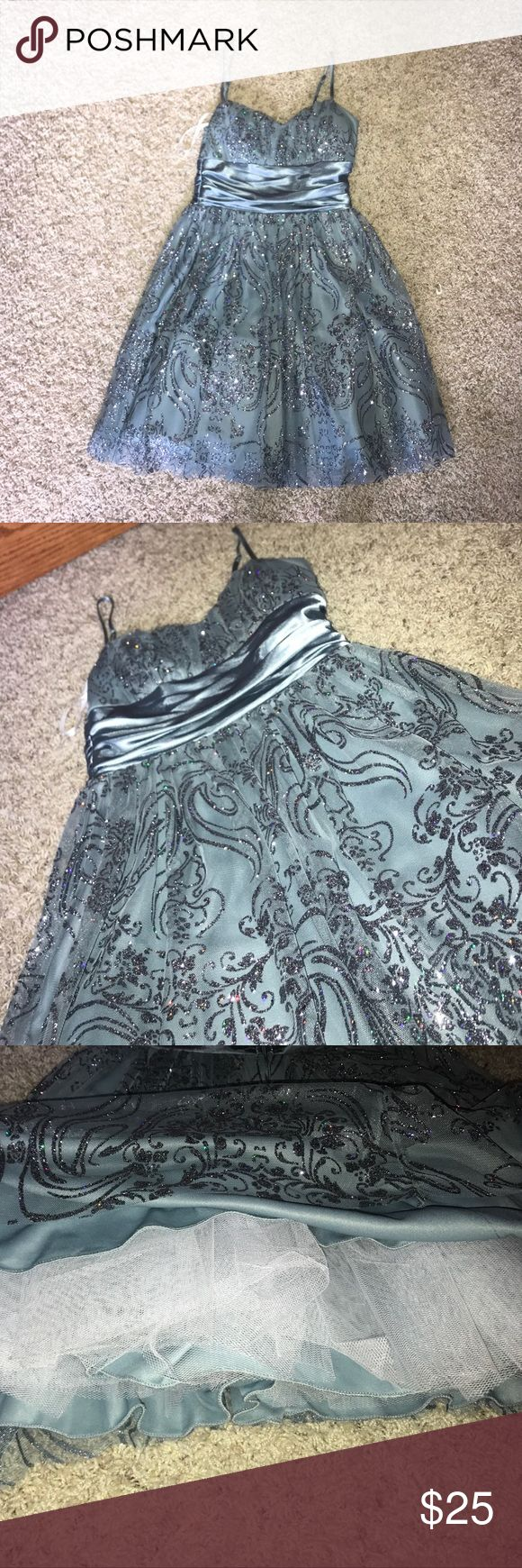 B Smart Homecoming Dress Perfect condition! Only worn once. Perfect for HOMECOMING or WINTER FORMAL!!! Beautiful icy blue color. Size 5 B Smart Dresses Asymmetrical
