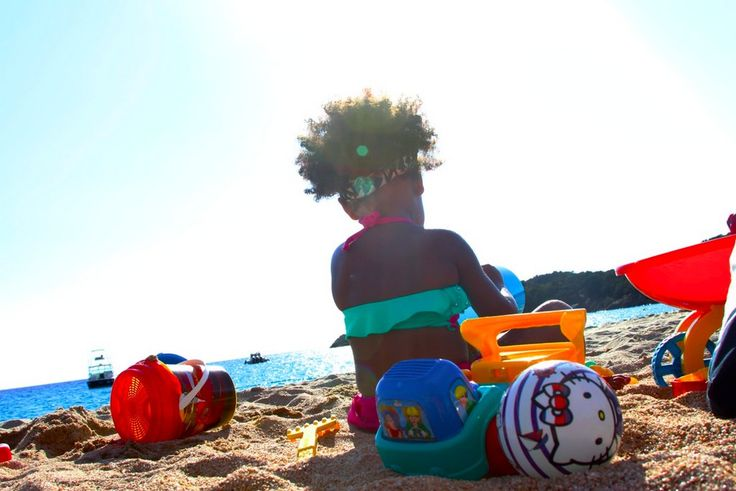 Blue Ivy playing on the beach during her mom's birthday getaway in Corsica. Image Source: Beyoncé Knowles