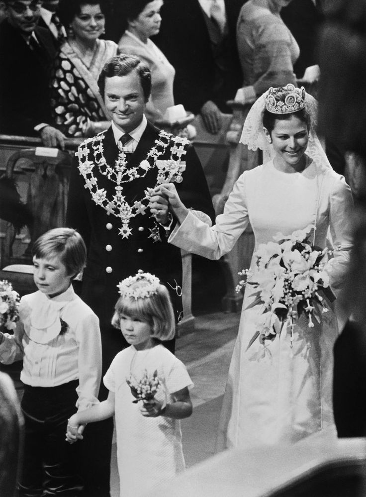 Silvia Sommerlath married King Carl XVI Gustaf of Sweden wearing a simple yet elegant gown by Marc Bohan fo...
