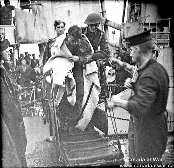 Soldiers who took part in Operation Jubilee, the raid on Dieppe, disembarking from a Royal Navy destroyer in England.