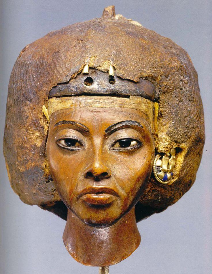 Portrait head of Queen Tiye, 18th Dynasty, 1382 - 1344 B.C.  Altes Museum, Berlin.