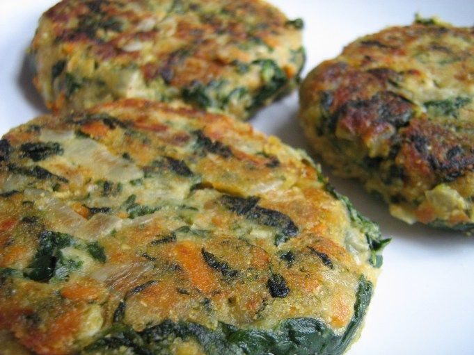 Chickpea/Spinach Burgers -1 medium onion, minced -3 cloves garlic, crushed -1 c. chickpeas -3 c. packed spinach leaves -1 carrot, grated -2 tbsp. soy sauce (likely less if you're using canned/salted chickpeas) -1 tsp. cumin -2 tbsp. peanut butter -1 tbsp. nutritional yeast -1 tsp. sriracha hot sauce -1/2 c. chickpea flour