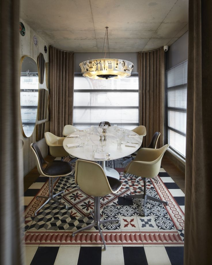 Tile dining rug. Ma Cocotte Restaurant, Paris by Philippe Starck