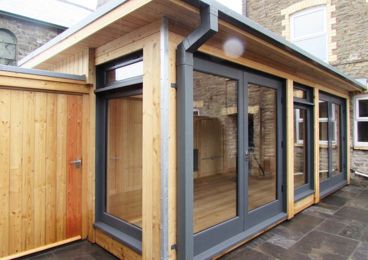 Home Extension Wales, Modern Timber Sun Room Larch Cladding Courtyard Building