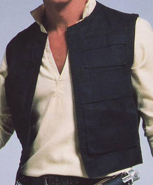 There is no doubt that Han Solo is famous for his signature vest he spotted carrying on his debuted appearance in the 1977's blockbuster movie.  Han Solo is a cool, fearless guy who showed his sophistication from years, his vest made up of black cotton fabric. It was detailed collar less style, four flapped front pockets and a big one on back.