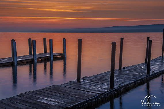 Save 15% with this coupon code              KCPPIN15 Getting a sunrise in the Upper Peninsula in Summer requires you getting up really early. I was able to catch on of the most beautiful sunrises I have ever seen here in Munising Michigan. Here is a view of a couple of docks on Lake Michigan.