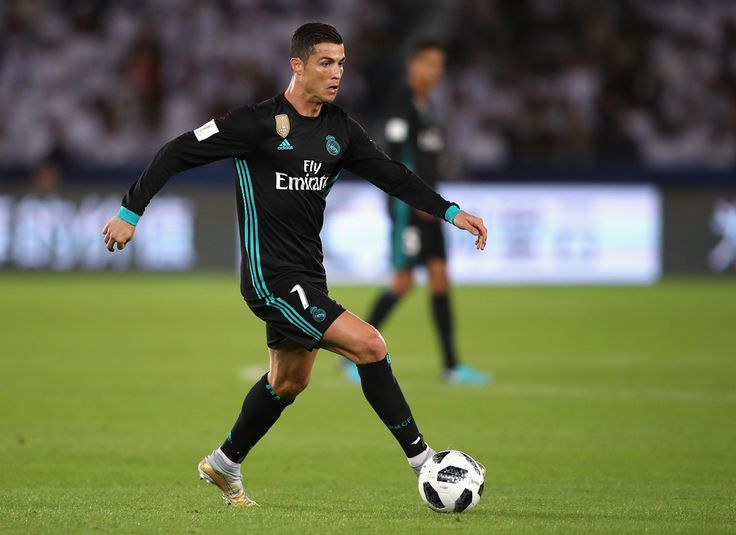Cristiano Ronaldo Photos - Cristiano Ronaldo of Real Madrid runs with the ball during the FIFA Club World Cup UAE 2017 semi-final match between Al Jazira and Real Madrid on December 13, 2017 at the Zayed Sports City Stadium in Abu Dhabi, United Arab Emirates. - Al Jazira v Real Madrid CF - FIFA Club World Cup UAE 2017