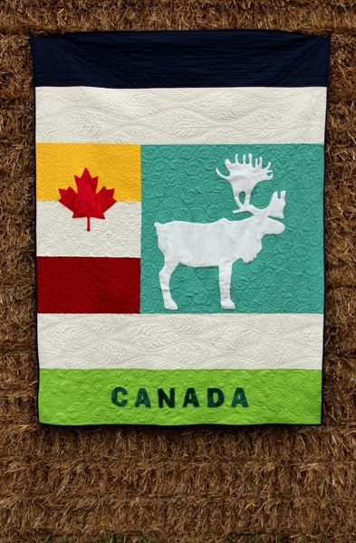 A striking new quilt that you will love, because it is unforgettable. This simple quilt features a caribou, maple leaf, and the word Canada