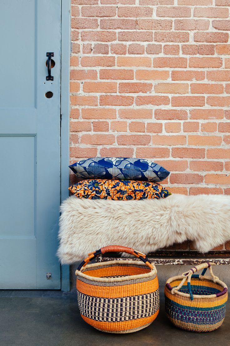 African Batik Pillows And Woven Baskets.
