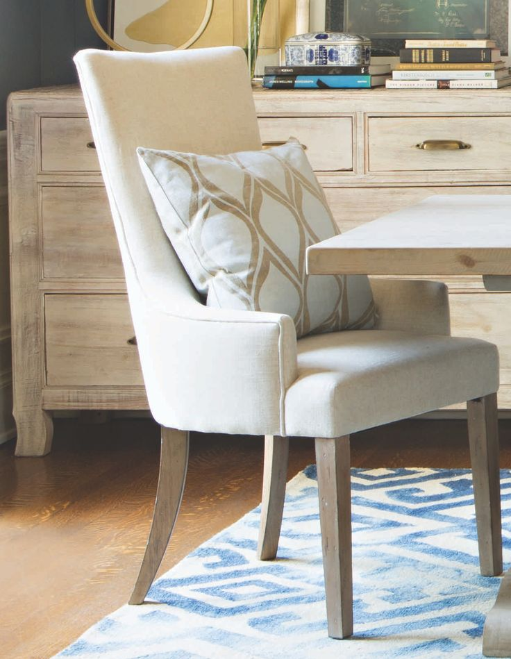 Unwind While You Dine On Our Shapely Zane Arm Chair Upholstered In Cream Colored