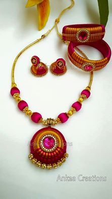a complete handmade silk thread neckset with double shade jhumka's and kada bangles...perfect match for silk sarees...https://www.facebook.com/ankaa.creations