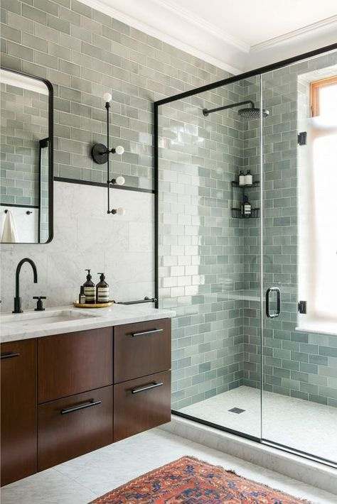 The cool green subway tiles in this Prospect Park West townhouse are  complemented by a contrasting rust-colored rug. The Apparatus Studio  sconces and black ...
