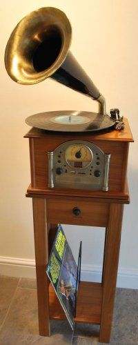 Gramophone Style Voice Nostalgia Retro Music System with Turntable Record Player - Radio - CD Player - MP3 Playback (USB / SD Card) Stereo Music Centre with His Masters Horn (inc Table Stand with built in Sub Woofer Speaker) Steepletone Phono 1 - LIGHT Wood Finish Steepletone http://www.amazon.co.uk/dp/B006IJIHTI/ref=cm_sw_r_pi_dp_Uv6Cub1DCD946