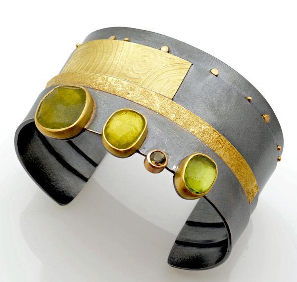 Moss green Strata cuff: Umba sapphire, tourmaline, andalusite, peridot, set in 18k & 22k gold, oxidized silver. sydney lynch