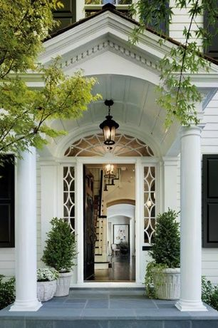 Traditional Entryway with flush light, French doors, Concrete tile , Columns, Arched window, Transom window