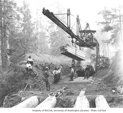 Asian track crew laying railroad track using a track machine, Schafer Brothers Logging Company, n.d. :: Kinsey Brothers Photographs of the Lumber Industry, 1890-1945