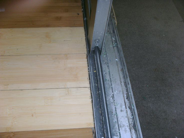 What is the best way to replace the rollers on a sliding glass door?