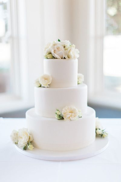 An elegant and simple three tier white wedding cake with beautiful white flowers as detail. Discover Vênsette Weddings: http://vensette.com/bridal_inquiries
