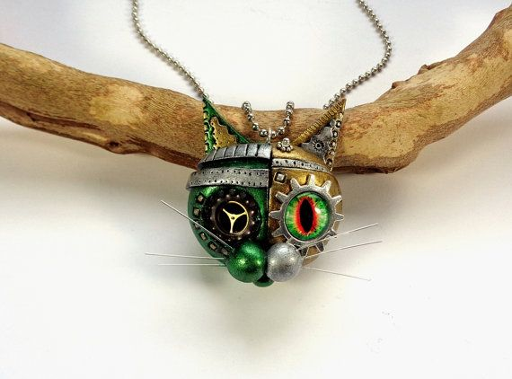 STEAMPUNK JEWELRY, Cat Lover Gift, Steampunk Cat, Steampunk Necklace, Valentines Day, Steampunk Lover Gift, Steampunk Pendant, Cat Jewelry  ✴✴✴✴✴✴✴✴✴✴✴✴✴✴✴✴✴✴✴✴✴✴✴✴✴✴✴✴✴✴✴✴✴✴✴✴✴✴✴  DESCRIPTION  Hi!!! My name is WILFRED, I´m a mechanical - steampunk cat.  I made this necklace entirely with my own hands, without molds, with polymer clay, steampunk pieces and Cléopâtre shiny vitrifying varnish.   ♥♥♥ All my steampunk cats are marked with my initials in the back ♥♥♥ Each piece is an handmade...