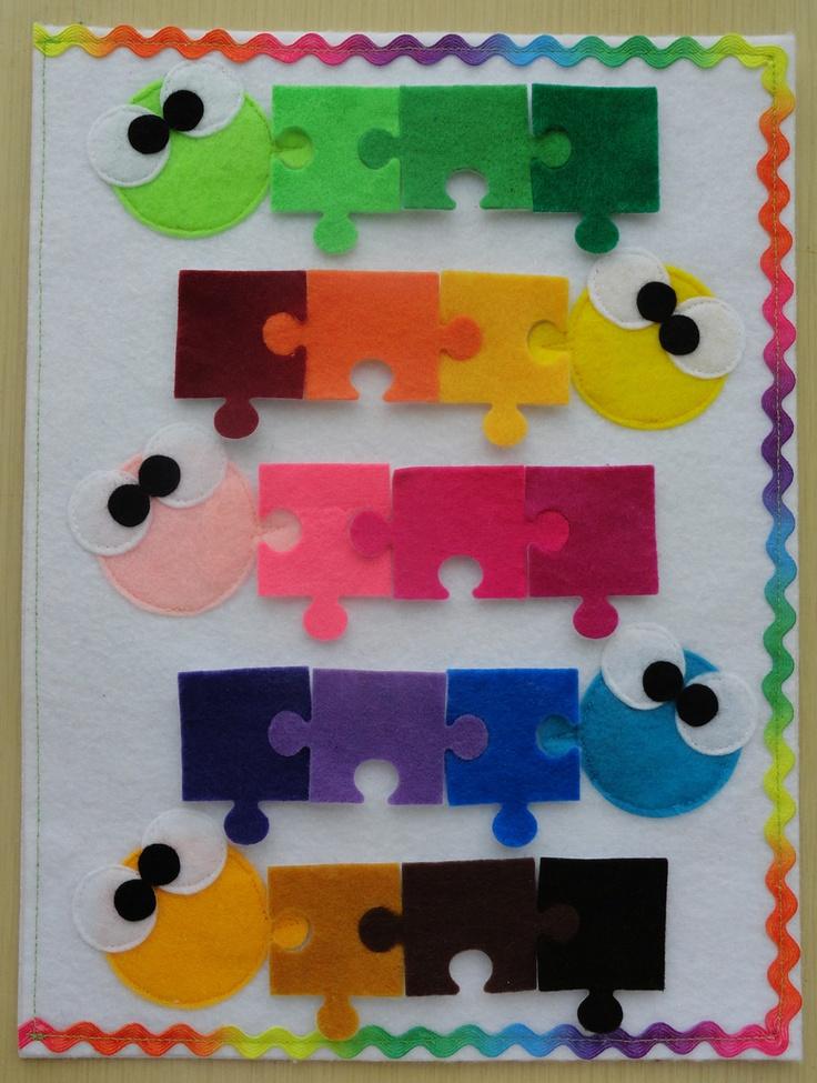 Beeld: kleurenleer de puzzelstukjes zijn primaire kleuren, hoofdjes secundaire of tertiare Would be great for teaching value.