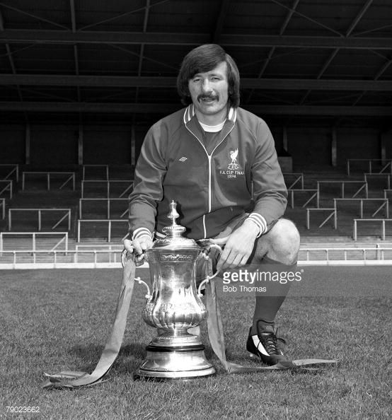 Sport Football England August 1974 Liverpool FC Photocall Liverpool FC's Tommy Smith is pictured with the FA Cup trophy that his side won against Newcastle United
