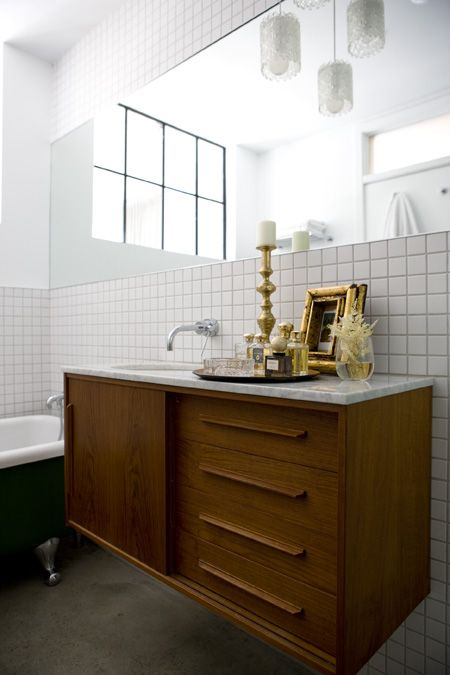 Wow. I like this one. Floating sink on white tile.