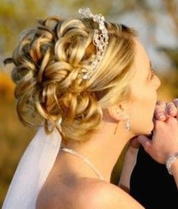 bride updo with rolls and tiara and veil