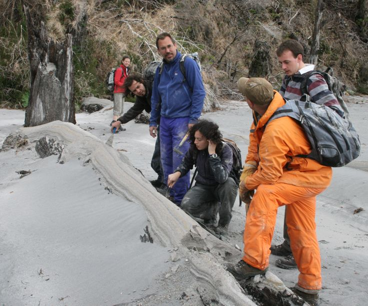 Inspecting fresh ash and pumice deposits from the ongoing eruption of Chaiten volcano, Chile, in 2009.