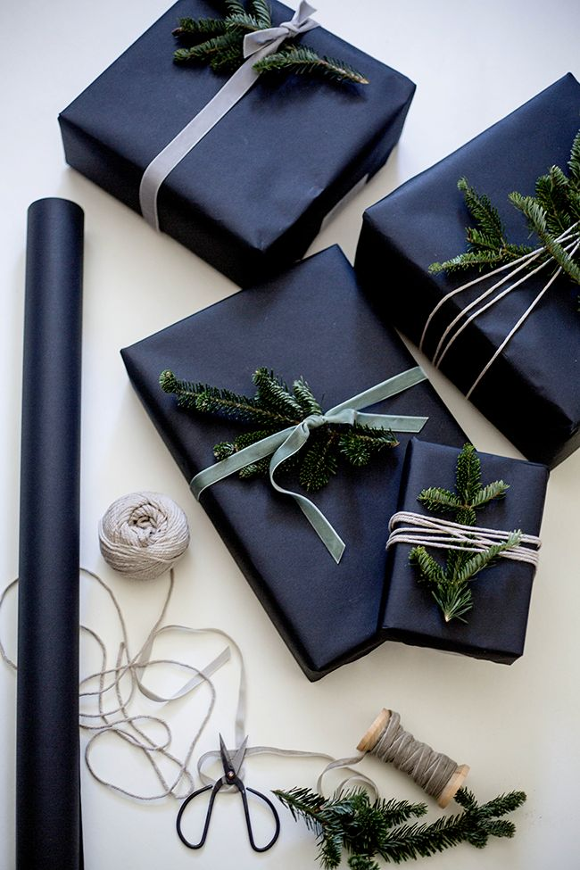 Dark Gift Wrapping with Pine Branches