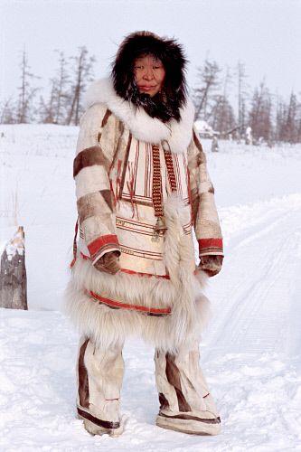 Nadiya Asyandu, a Nganasan woman, dressed in traditional reindeer skin clothing. Taymyr, Northern Siberia, Russia.