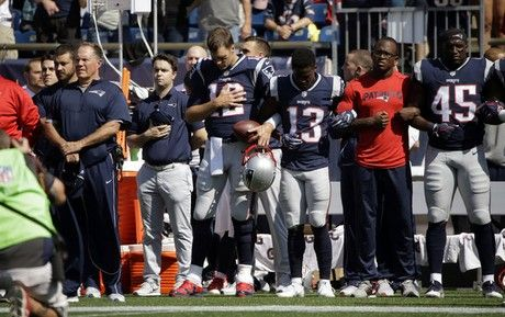 9/24/17 New England Patriots head coach Bill Belichick, left, and Tom Brady (12) Phillip Dorsett (13) Matthew Slater, second from right, and David Harris (45) stand during the national anthem before an NFL football game against the Houston Texans, Sunday, Sept. 24, 2017, in Foxborough, Mass.