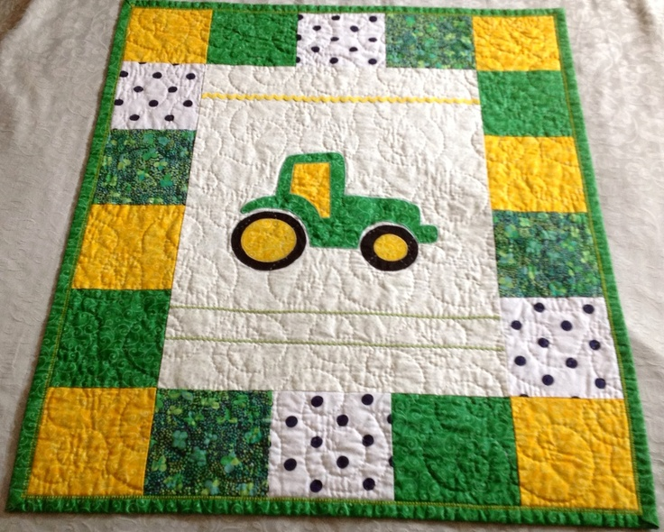 John Deere green tractor for baby boy. Crib, and hand quilted.
