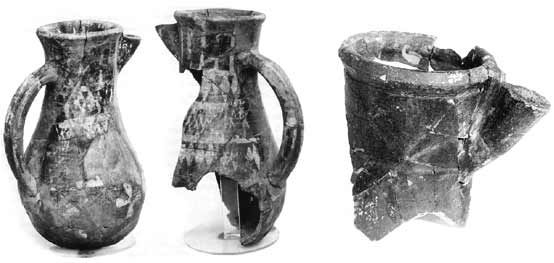 Tating ware pottery from Kaupang. Notice cross motif on the left hand pitcher.  To the right the top of one of the Borg pitchers (from : Mikkelsen in Viking 2002 : 122; Munch, Johansen & Roesdahl 2003 : 207).