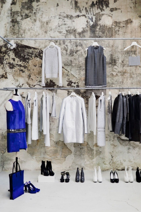 visual #merchandising Gorgeous wall but also the clothes are broken up by how they place them, some sideways and some straight on.  Also notice the shoes are super neat and not all the same height and broken up a little by color.