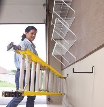 Here is an easy way to hang a ladder where you can reach it.