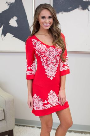 Our stunning Lasting Impression dress is back! It features a beautiful textured design in white paired with trendy red fabric for an elegant look.It also has 3/4 length sleeves, a scoopneck, and soft
