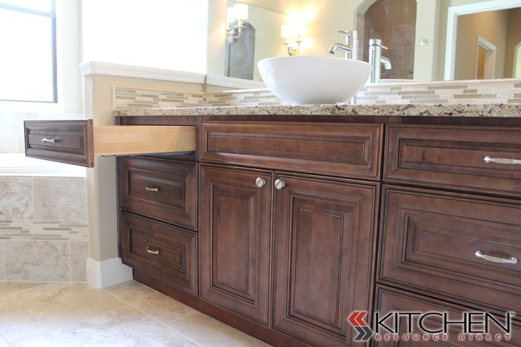 A beautiful wood stained vanity with a vessel sink for Bristol chocolate kitchen cabinets