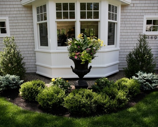 moulded bay window light gray shakes landscaping ideas