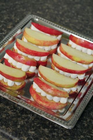 Halloween teeth snacks! Apples, marshmallows, and a little peanut butter to hold it all together.