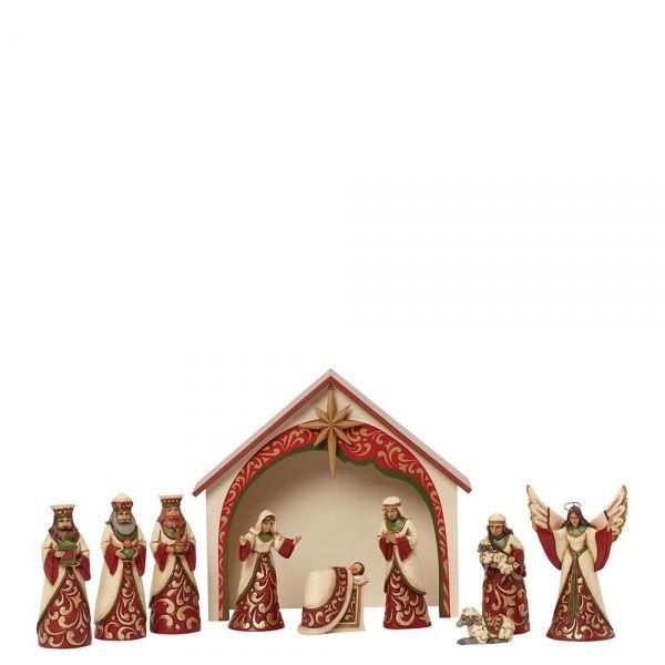 Jim Shore kerststal Ivory and Gold Mini Nativity set 10. Prachtig uitgevoerd in de kleuren rood, goud en ivoor.