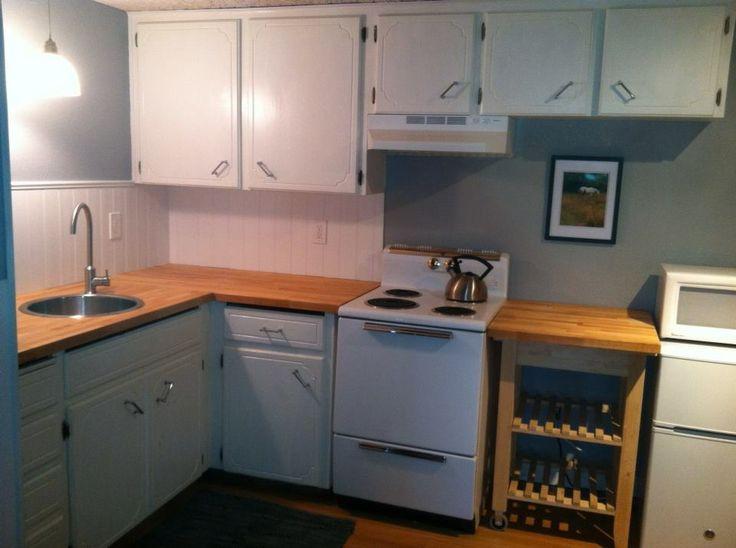 Small kitchen redo. Ikea butcher block countertops, sink & faucet. Vintage GE stove.  Plastpro beadboard backsplash from Home Depot.