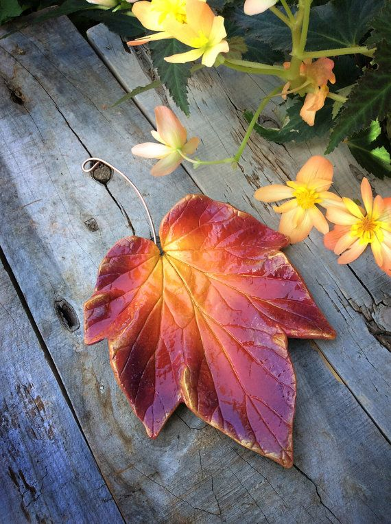 Hanging concrete leaf casting in burgundy, red, orange, yellow with copper wire hanger