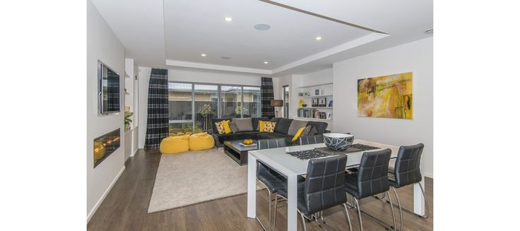 yellow accent living/dining room