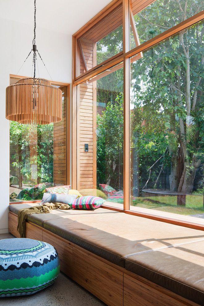 Window seat living room contemporary with casement windows toy storage concrete floor