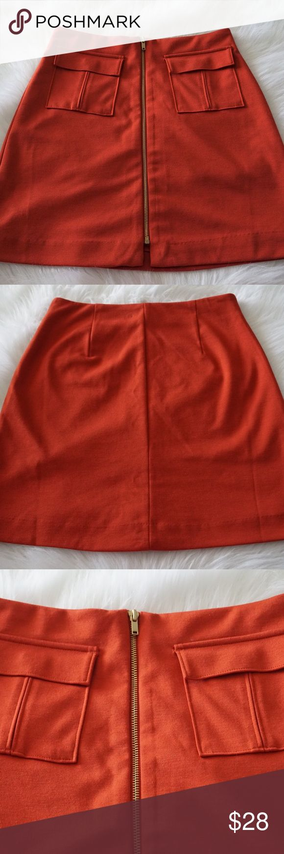 Banana Republic Burnt Orange Ponte Military Skirt 🔥Really cute ponte military inspired Skirt! Love the burnt orange color, my favorite color! Front zipper and two flap pockets. Great for the summer time and perfect for the fall too with tights! Measurements: waist- 14 inches across, top to bottom- 17.5 inches from center.🚫 trades!🔥 Banana Republic Skirts Mini